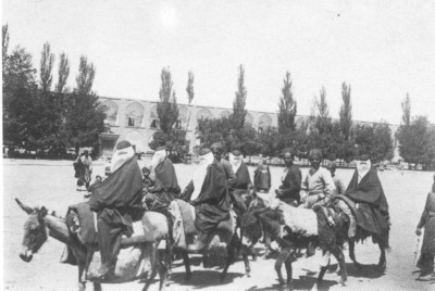 Women on donkeys in Ispahan.